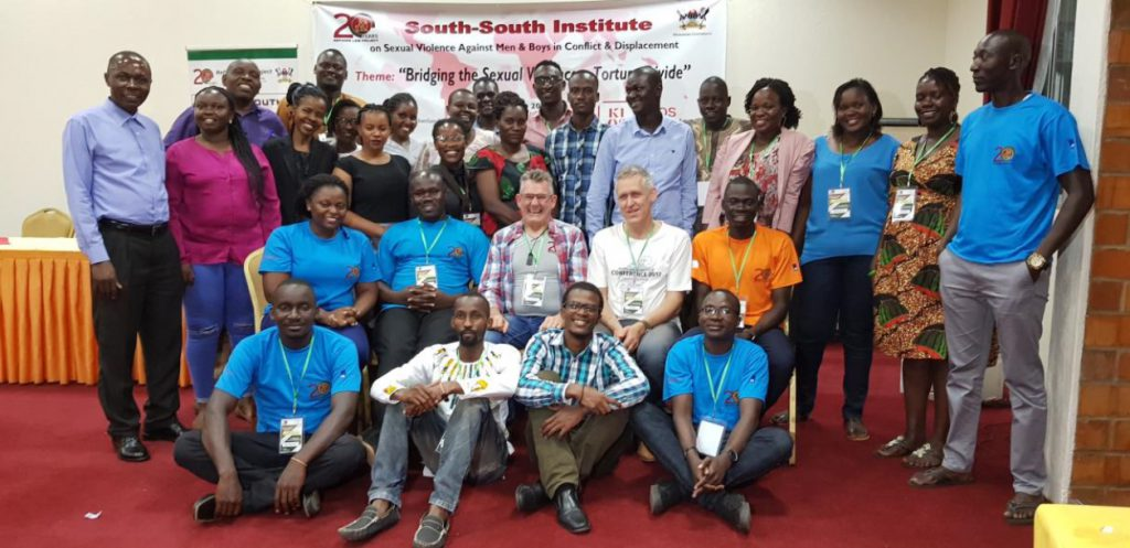 Ken Clearwater (centre) with participants in the 4th SSI conference in Kampala in May 2019